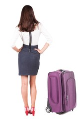 back view of traveling business woman with suitcas.