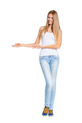 Full length of beautiful blond woman pointing at copy space