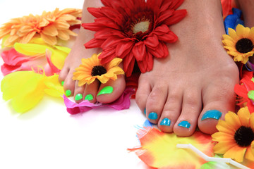 woman legs (pedicure - colored nails)