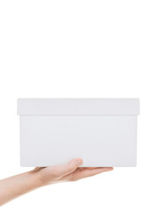 Hand holding white cardboard box. Isolated on white background w