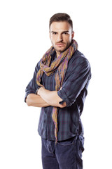 handsome young man with a scarf and crossed arms
