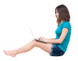 Woman sitting on floor with laptop.