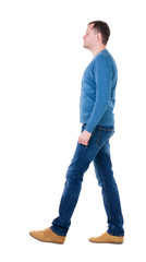Back view of going  handsome man in blue pullover.