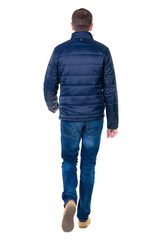 Back view of going  handsome man in jeans and jacket.
