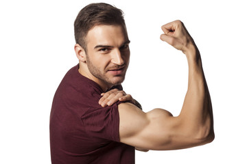 young handsome guy shows his strong arm