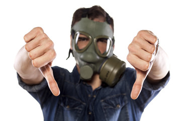 man with a gas mask showing the thumbs down