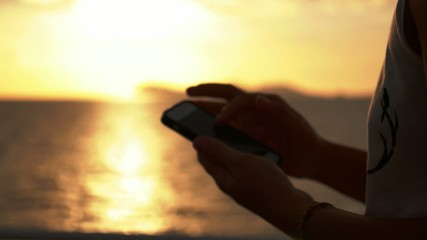 Woman Hands Holding Smartphone and Browsing Internet. Close up.