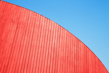 Red wooden planks wall and blue sky. Abstract background