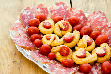Taralli piccanti with tomato mayonnaise and salami