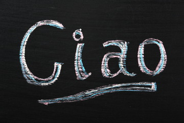 The Italian word Ciao written on a blackboard