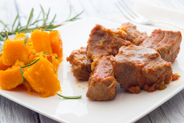 Pork stew garnished with pumpkin