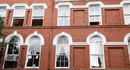 White Windows on Old Red Brick Wall