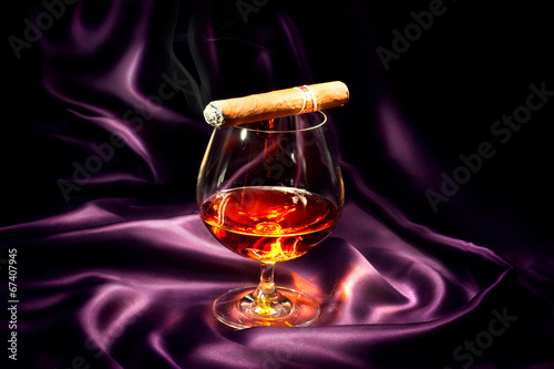 Cognac and cigar. Glass of brandy over dark background - 67407945