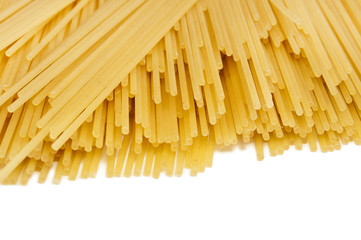 Uncooked spaghetti on a white background