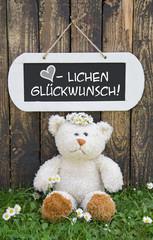 Glückwunschkarte mit Text und Teddybär zur Geburt