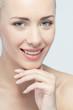 Closeup portrait of young beautiful green eyed woman touching he