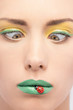 Closeup portrait of beautiful woman with green lipstick and deco