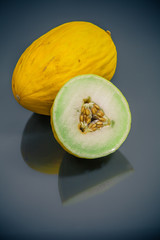 fresh yellow korean melon cut and whole closeup
