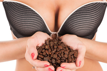 female breast and coffee in hand