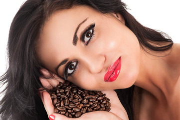 portrait of a beautiful brunette with coffee in hand