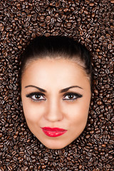 beautiful woman face in the coffee beans