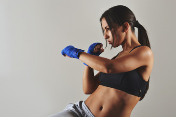 fitness woman with the blue boxing bandages, studio shot