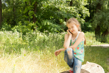 Young girl playing in woodland