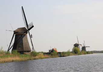 Windmills on the canal bank.