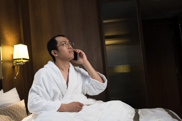 Mature Asian man in bathrobe