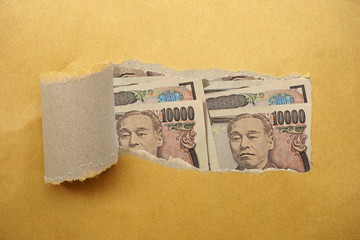Torn envelope full of Japan Yen