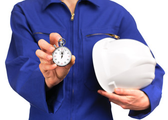 woman in blue work uniform holding a stopwatch and a helmet