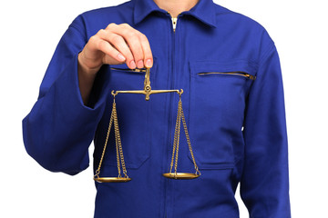 woman in blue work uniform holding a scale of justice