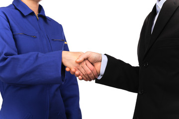 woman in blue work uniform and a man in suit shaking hands
