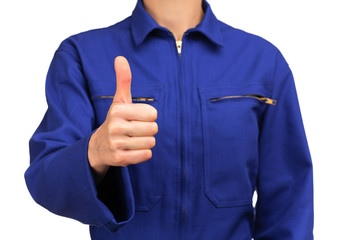 woman in blue work uniform making the OK sign