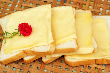 cheese the place on a slice of bread.