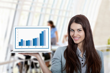 Beautiful Businesswoman Presenting Chart on Laptop