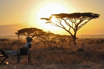 man sitting at sunset