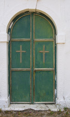 Green door of a church