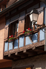 Street with half-timbered medieval houses in Eguisheim in Alsace