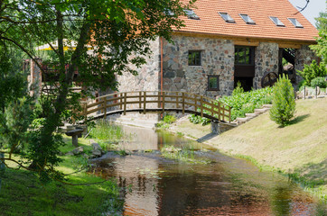 park with bridge over stream ancient brick manor