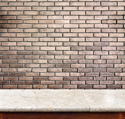 Empty marble table and brick wall in background. product display