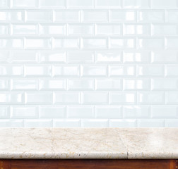 Empty marble table and ceramic tile brick wall in background. pr