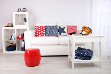 White couch with multicolor pillows and plaid in modern living