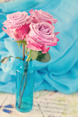Pink flowers. Beautiful roses in a blue vase.