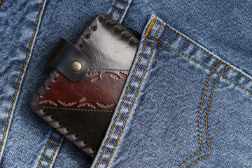 Leather wallet in a pocket