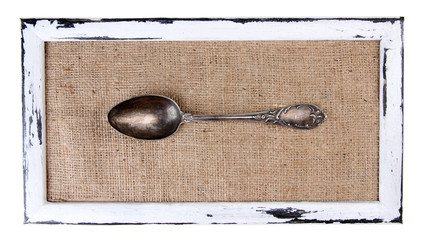 Wooden frame and vintage cutlery  isolated on white