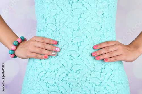canvas print picture Female hand with stylish colorful nails, close-up,