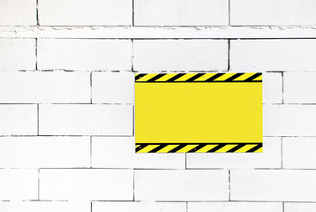 Cement block wall with blank warning poster,template to fill you