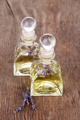 Lavender oil with flowers on wooden table