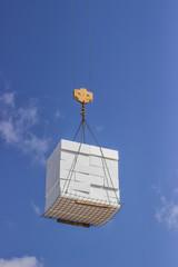 crane lifting stacked white styrofoam sheets 2